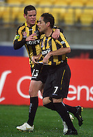 Troy Hearfield (left) congratulates Leo Bertos for scoring the winning goal during the A-League football match between Wellington Phoenix and Perth Glory at Westpac Stadium, Wellington, New Zealand on Sunday, 16 August 2009. Photo: Dave Lintott / lintottphoto.co.nz