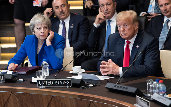 11 July 2018, Brussels, Belgium: Theresa May (L), Prime Minister of the United Kingdom, and Donald Trump, President of the United States of America, sit next to each other at the first work session of the North Atlantic council at the NATO Summit. From 11 July 2018 until 12 July 2018 government heads of the 29 NATO member states and European Union representatives, will participate in the Summit of the North Atlantic Treaty Organization. Photo: Bernd von Jutrczenka/dpa /MediaPunch ***FOR USA ONLY***