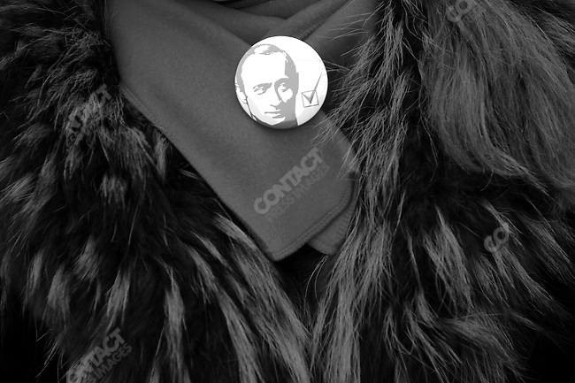 At a meeting of the pro-Kremlin youth organisation Nashi aimed at bringing out the vote for United Russia and aimed in particular against the opposition group Other Russia, a girl wore a badge with the face of Vladimir Putin and a tick, marking a vote for United Russia, next to it. Moscow, Russia, November 19, 2007