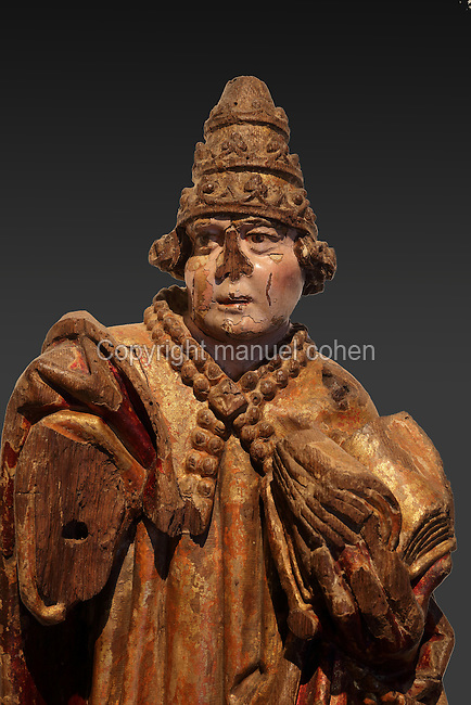 Wooden polychrome sculpture of Pope St Gregory, pope 590-604 AD, 16th century, by Olivier de Gand, d. 1512, in the Museu Nacional de Machado de Castro, Coimbra, Portugal. The museum was opened in 1913 and renovated 2004-2012. The city of Coimbra dates back to Roman times and was the capital of Portugal from 1131 to 1255. Its historic buildings are listed as a UNESCO World Heritage Site. Picture by Manuel Cohen