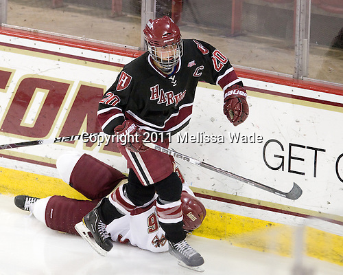 Kate Buesser (Harvard - 20), Jessica Martino (BC - 26) - The Boston College Eagles defeated the Harvard University Crimson 3-1 to win the 2011 Beanpot championship on Tuesday, February 15, 2011, at Conte Forum in Chestnut Hill, Massachusetts.