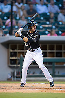 Ethan Wilson (12) of the Charlotte Knights at bat against the Gwinnett Braves at BB&T BallPark on August 11, 2015 in Charlotte, North Carolina.  The Knights defeated the Braves 3-2.  (Brian Westerholt/Four Seam Images)