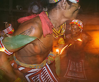 "Aman Lepon and his father, Aman Lau Lau, performing ""turuk laggai"", the Mentawai traditional dance. The Mentawai are the tribes living traditionally in the island of Siberut, Indonesia. Here, where the changes came slow, some of the people are still living like their ancestors did centuries ago. They s till practice ancient religion called Arat Sabulungan, which believe that everything in the forest has a spirit."