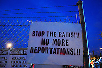 "Phoenix, Arizona. September 22, 2012 - A poster against immigration raids and deportations of undocumented immigrants in Arizona and elsewhere in the United States is seen on display on the fence of the lot where the ""Festival of Resistance"" was held. Photo by Eduardo Barraza © 2012"
