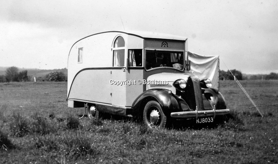 BNPS.co.uk (01202 558833)<br /> Pic: Bonhams/BNPS<br /> <br /> A pre war family outing in the motorhome.<br /> <br /> The interior was designed around Capt Dunn's wheelchair after he contracted polio on his honeymoon.<br /> <br /> Britain's first motorhome revealed - As eccentric British pioneers 80 year old home on wheels trundles up for auction.<br /> <br /> The pre-war creation of Capt Dunn, an aristocrat from Bexhill-on-Sea, is believed to be the earliest motorhome in the UK.<br /> <br /> Enterprising Dunn shipped a Pontiac Six chassis over from America in 1935, engaged local coach builders to craft a bespoke<br /> <br /> home from home on to the back, and then set off into the British countryside in his new creation.<br /> <br /> The unique vehicle has been untouched since Dunn died in the 1940's and auctioneers Bonhams are now selling the time capsule<br /> <br /> camper at the Goodwood Revival on 10th September with a £40,000 estimate.