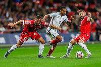 Theo Walcott (Arsenal) of England (centre) tries to find a way through the Malta defence during the FIFA World Cup qualifying match between England and Malta at Wembley Stadium, London, England on 8 October 2016. Photo by David Horn / PRiME Media Images.