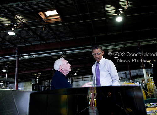 Robert B. Gawne, CEO of Stromberg Metal Works, Inc, leads United States President Barack Obama on a tour of the company's factory, Friday, October 29, 2010 in Beltsville, Maryland.  President Obama toured the company before delivering an address about the economy..Credit: Brendan Smialowski / Pool via CNP.