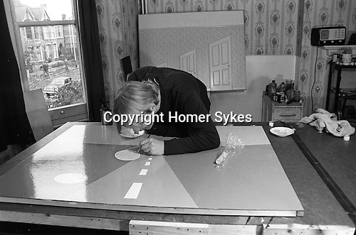 Patrick Hughes artist in his London studio, 43 Idmiston Road, London SE27 1968 UK.Painting thats is being worked on destroyed.<br />