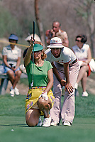 Donna Caponi Young lines up putt at the Carlton, a golf tournament she won on the LPGA Tour played at the Calabasas Country Club, Calabasas, California, September 1976. Photo by John G. Zimmerman.