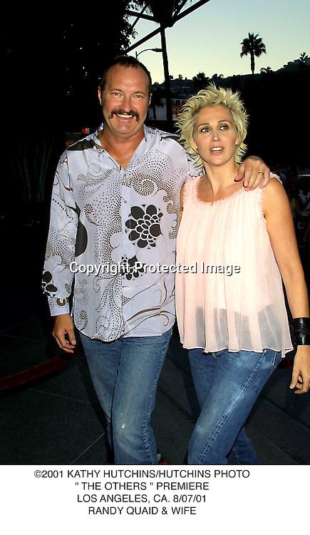 "©2001 KATHY HUTCHINS/HUTCHINS PHOTO."" THE OTHERS "" PREMIERE.LOS ANGELES, CA. 8/07/01.RANDY QUAID & WIFE"