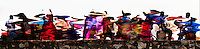 An abstract interpretation of a brightly dressed musical troupe singing and dancing along the old Portuguese ramparts. (Photo by Matt Considine - Images of Asia Collection)