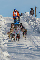 Cindy Abbott on Cordova St. hill during the Anchorage start day of Iditarod 2018 on Cordova St. hill during the Anchorage start day of Iditarod 2019