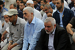 Chairman of the political bureau of the Hamas Palestinian Islamist movement, Ismail Haniyeh and Hamas's leader in the Gaza Strip Yahya Sinwar participates in the funeral of 14-year-old Palestinian boy Yasser Abu Al-Naja, who was killed by Israeli troops during clashes in tents protest where Palestinian demand the right to return to their homeland at the Israel-Gaza border, in Khan Younis, in the southern Gaza Strip June 30, 2018. Photo by Ashraf Amra