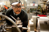 Enrique Ortega (cq) who has worked at Manda Machine for eight years, works on a manual lay machine at the company's manufacturing warehouse in Dallas, Texas, Wednesday, February 9, 2011. With the economy on the rise many companies, including Manda Machine, are looking to start hiring as well as offer raises to employees..Matt Nager for the Wall Street Journal