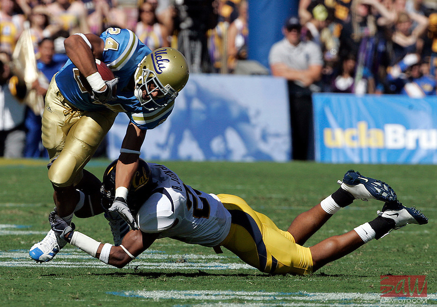 LOS ANGELES,CA - OCTOBER 9,2009: Cal's Brett Johnson takes down UCLA's Christian Ramirez during 2nd half action. UCLA Bruins vs. California Golden Bears, in an NCAA Pac 10 football game at the Rose Bowl, Sat. Oct 17, 2009. Cal won 45-26..(Photo: Spencer Weiner/Los Angeles Times)