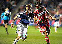 Chicago midfielder Baggio Husidic (9) pulls Chivas midfielder Blair Gavin (18) away from the ball by his jersey.  The Chicago Fire tied Chivas USA 1-1 at Toyota Park in Bridgeview, IL on May 1, 2010.