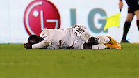 Pictured: Modou Barrow of Swansea on the ground Saturday 10 January 2015<br />