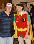 Gavin Smith shows of Joe Seebok on Day 1A of the WSOP Main Event. Seebok lost a bet to Smith and had to wear a superhero costume.