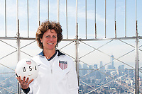 Former women's national team player Michelle Akers poses for a photo on the observation deck of the Empire State Building during the centennial celebration of U. S. Soccer in New York, NY, on April 05, 2013.