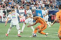 Foxborough, MA - June 29, 2019:  In a Major League Soccer (MLS) match, New England Revolution (blue/white) defeated Houston Dynamo (orange), 2-1, at Gillette Stadium on June 29, 2019 in Foxborough, MA.