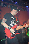Steve Klein (guitar) of New Found Glory performs at Harro East Ballroom in Rochester, New York circa October 31, 2001.  Photo Copyright Mike Janes Photography