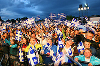 Quebec City, June 23, 2007 ? Spectators  wave their flags  during the St-Jean-Baptiste show on the Plains of Abraham in Quebec City June 23, 2007. Thousand of Quebecer gathered on the Plains to celebrates their National day.
