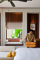 A member of the hotel staff puts the finishing touches to one of the bedrooms at the Maia Luxury Resort & Spa