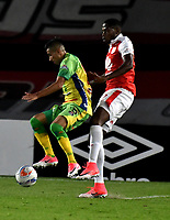 BOGOTA - COLOMBIA - 17 - 03 - 2018: Leyvin Balanta (Der.) jugador de Independiente Santa Fe, disputa el balón con Diego Gomez (Izq.) jugador de Atletico Huila, durante partido de la fecha 9 entre Independiente Santa Fe y Atletico Huila, por la Liga Aguila I 2018, en el estadio Nemesio Camacho El Campin de la ciudad de Bogota. / Leyvin Balanta (R) player of Independiente Santa Fe struggles for the ball with Diego Gomez (L) player of Atletico Huila, during a match of the 9th date between Independiente Santa Fe and Atletico Huila, for the Liga Aguila I 2018 at the Nemesio Camacho El Campin Stadium in Bogota city, Photo: VizzorImage / Luis Ramirez / Staff.