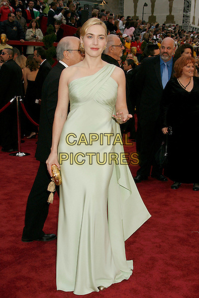 KATE WINSLET.The 79th Annual Academy Awards - Arrivals held at the Kodak Theatre. Hollywood, California, USA,.25 February 2007..oscars red carpet full length pale green dress gown white cream one shoulder strap hand.CAP/ADM/RE.©Russ Elliot/AdMedia/Capital Pictures.