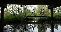 10 MAY 2015 - ST. NEOTS, GBR - Competitors cross a bridge during the 2015 British Sprint Triathlon Championships at Riverside Park in St. Neots, Great Britain (PHOTO COPYRIGHT © 2015 NIGEL FARROW, ALL RIGHTS RESERVED)