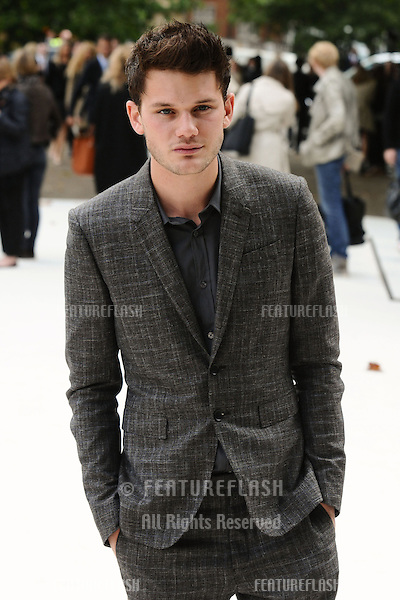 Jeremy Irvine arriving for the Burberry Prorsum catwalk show as part of London Fashion Week SS13, Kensington Gardens, London. 17/09/2012 Picture by: Steve Vas / Featureflash