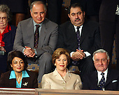 First lady Laura Bush sits with invited guests from the Iraqi Governing Council for her husband, United States President George W. Bush's 2004 State of the Union Address to a Joint Session of the United States Congress at the Capitol in Washington, D.C. on January 20, 2004.  Left to right in the top row: Doctor Ahmed Chalabi, Iraqi Governing Council; and Hoshyar Zebari, Iraqi Interim Foreign Minister.  Left to right on the bottom row: Ms. Rend al-Rahim, Iraqi Senior Diplomatic Representative; first lady Laura Bush; and Doctor Adnan Pachachi, President, Iraqi Governing Council.<br /> Credit: Ron Sachs / CNP
