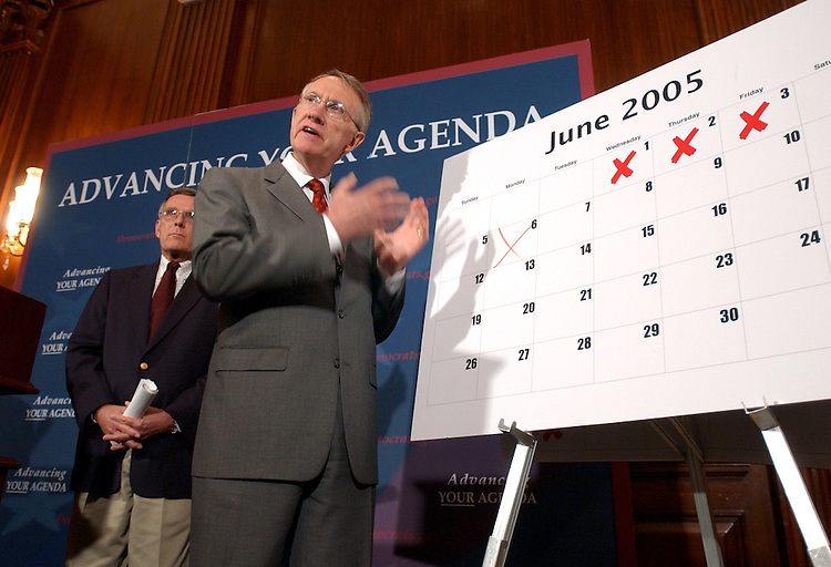 Senate Minority Leader Harry Reid, D-Nev., speaks at a news conference with Sen. Byron Dorgan, D-N.D., in which the Senators called on the Republican majority to join Democrats in addressing the agenda of the American people.  He flipped through a calendar indacting that there was little accomplished, thus far, in 2005.