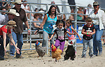 From left, Piper Colburn, 7, Kayleigh Gaudette and Kloe Abbott, both 5, participate in a chicken race at the 56th annual International Camel &amp; Ostrich Races in Virginia City, Nev. on Friday, Sept. 11, 2015. <br /> Photo by Cathleen Allison