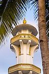 A mosque turret dominates the skyline near the Banda Neira port.