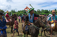 March 26, 2016 - Ratenggaro (Indonesia). Peter looks at the field where his team members are fighting. Peter is 15 years old and he participated in his first Pasola just 3 years ago. He confessed that he loves riding but he's still very scared of being hit by a spear and get injured. © Thomas Cristofoletti / Ruom