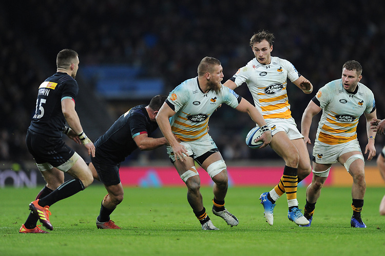 Brad Shields of Wasps offloads as he is tackled by Dave Ward of Harlequins during Big Game 11, the Gallagher Premiership Rugby match between Harlequins and Wasps, at Twickenham Stadium on Saturday 29th December 2018 (Photo by Rob Munro/Stewart Communications)