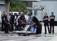 Jan. 16, 2013; Jupiter, FL, USA: Crew members surround the car of NHRA top fuel dragster driver Antron Brown during testing at the PRO Winter Warmup at Palm Beach International Raceway.  Mandatory Credit: Mark J. Rebilas-