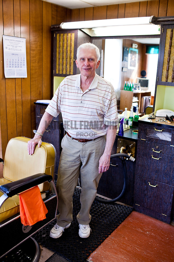 John Murray poses for a portrait in his barbershop located in the South side of Syracuse at 4403 S. Salina St.