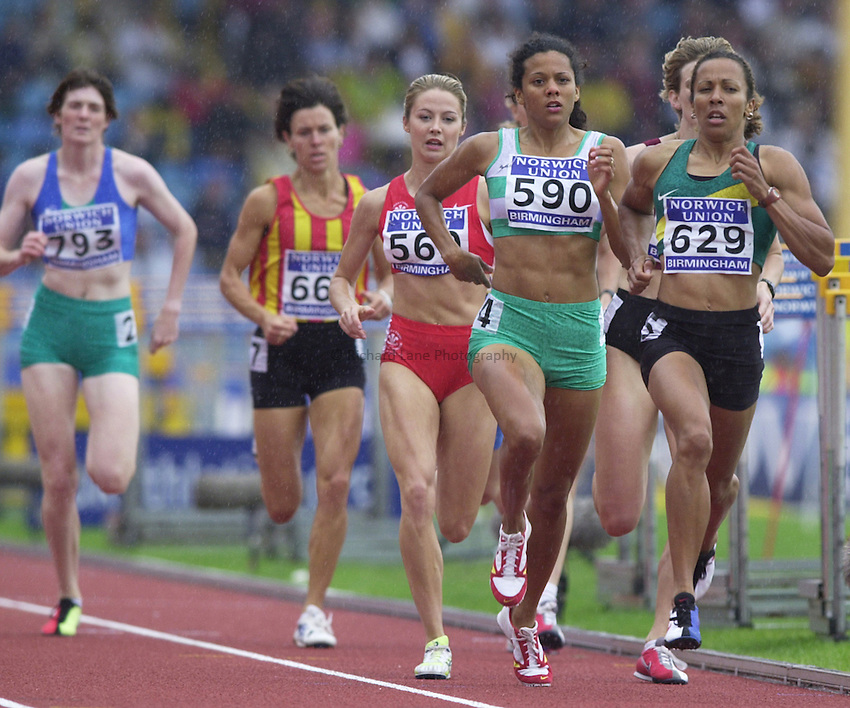 Photo. Richard Lane. .Norwich Union Olympic Trials and AAA Championships, Alexander Stadium , Birmingham. 13/8/2000.Kelly Holmes (629), pushed by Jo Fenn (590) runs to a comfortable victory in the Womens 800 metres.