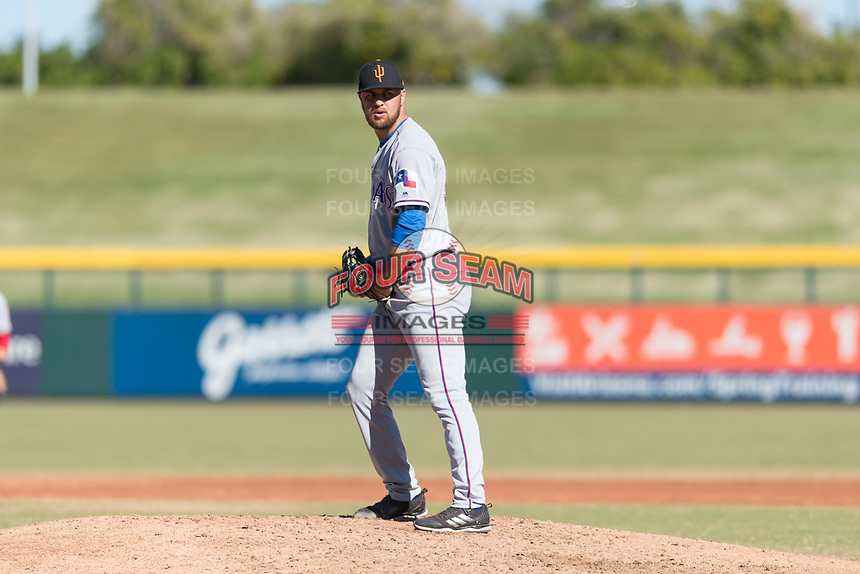 Surprise Saguaros relief pitcher Joe Kuzia (52), of the Texas Rangers organization, gets ready to deliver a pitch during an Arizona Fall League game against the Mesa Solar Sox at Sloan Park on November 15, 2018 in Mesa, Arizona. Mesa defeated Surprise 11-10. (Zachary Lucy/Four Seam Images)