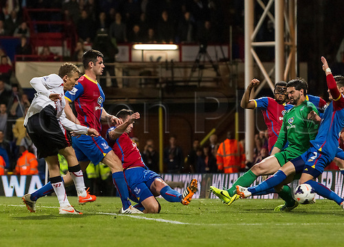 05.05.2014  London, England. Liverpool midfielder Lucas Leiva (21) forces last gasp defending from Palace defenders in the area late on during the Barclays Premier League match between Crystal Palace and Liverpool from Selhurst Park