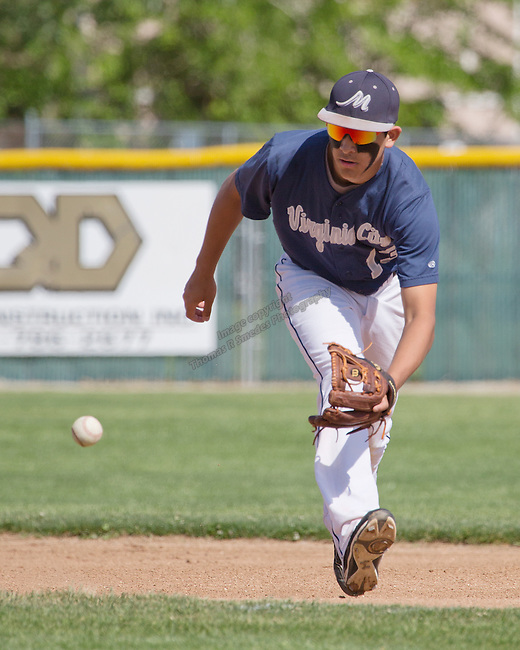 Virginia City shortstop Carlos Robledo fields the ball against Wells in the championship of the NIAA Division IV State baseball tournament on Saturday, May 24, 2014 at Sparks High School.