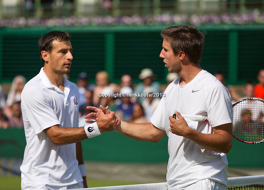 29-06-13, England, London,  AELTC, Wimbledon, Tennis, Wimbledon 2013, Day six, Igor Sijsling (NED) gives up the match and congratulates Ivan Dodig (CRO)left.<br /> <br /> <br /> <br /> Photo: Henk Koster