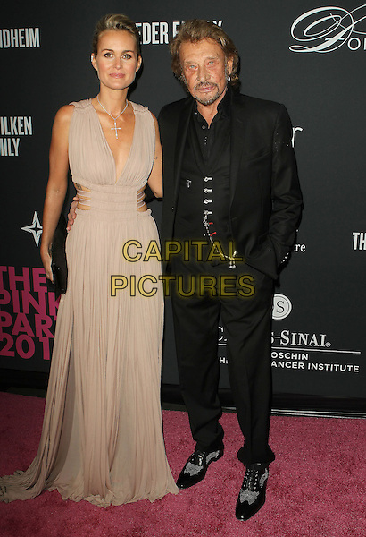 Laeticia Hallyday, Johnny Hallyday<br /> The Pink Party 2013 held at the Santa Monica Airport, Santa Monica, California, USA.<br /> October 19th, 2013<br /> full length dress clutch bag suit couple black goatee facial hair beige <br /> CAP/ADM/KB<br /> &copy;Kevan Brooks/AdMedia/Capital Pictures