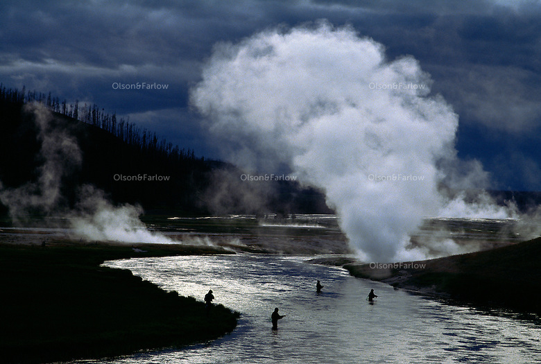 Fishermen in the Firehole River in Yellowstone National Park.  A catch- and- release policy was implemented by the park because of heavy fishing pressure.  The river is surrounded by  geyser  activity and these photographs were taken along the road between Norris Geyser and Old Faithful near Midway Geyser Basin.  .Yellowstone is the nations first National Park, it spans three states and holds 70% of the world's geothermal activity.