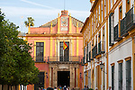 Spanish flag flying on historic buildings in the Alcazar palace area, Seville, Spain