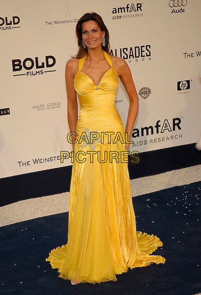 ISABELLA KRISTENSEN.amFAR's Cinema Against Aids Benefit - Arrivals, .59th International Cannes Film Festival,.Moulins de Mougins, Cannes, France, May 25th 2006..full length yellow dress silver star halterneck.Ref: KRA.www.capitalpictures.com.sales@capitalpictures.com.©Persun/Capital Pictures