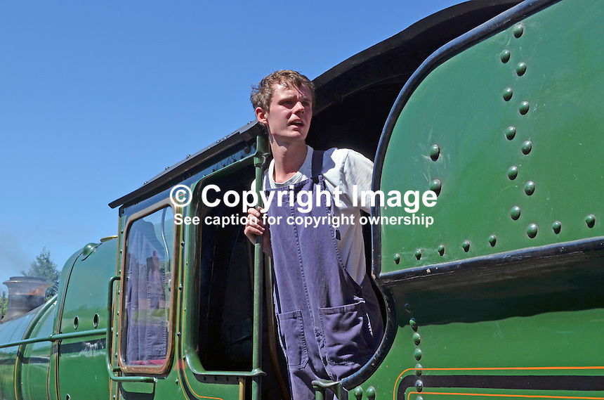James Auton, fireman, on the footplate of locomotive, 6960, West Somerset Railway, as it resumes its journey to Minehead after stopping at Watchet en route from Bishops Lydeard, UK, July, 2014, 201407093441<br />