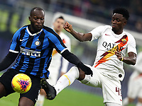 Calcio, Serie A: Inter Milano - AS Roma, Giuseppe Meazza stadium, December 6, 2019.<br /> Inter's Romelu Lukaku (l) in action with Roma's Amadou Diawara (r) during the Italian Serie A football match between Inter and Roma at Giuseppe Meazza (San Siro) stadium, on December 6, 2019.<br /> UPDATE IMAGES PRESS/Isabella Bonotto